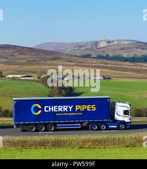 Cherry Pipes Limited HGV. M6 Northbound carriageway, Shap, Cumbria, England, United Kingdom, Europe. - Stock Image