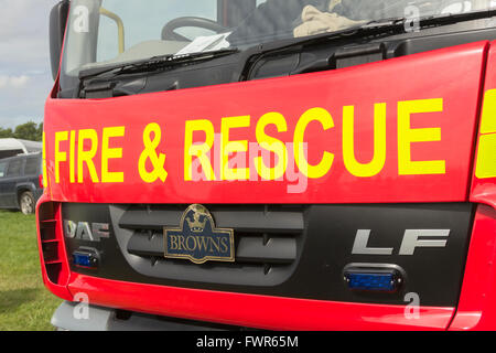 Fire and Rescue legend in bright yellow lettering on the front of a fire engine. The vehicle is a DAF LF series - Stock Image