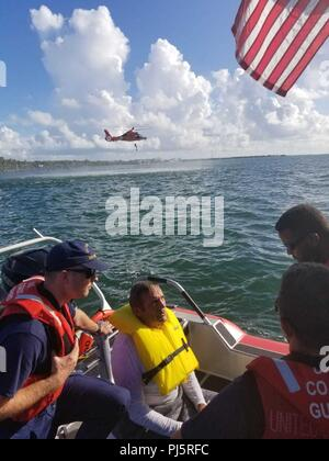 Robert Vonnegut sits aboard a Coast Guard Station Islamorada 33-foot Special Purpose Craft-Law Enforcement boat after being rescued by the crewmembers Aug. 27, 2018 near Tavernier, Florida. The boatcrew and a Coast Guard Air Station Miami MH-65 helicopter crew went searching for Vonnegut after watchstanders at Coast Guard Sector Key West received a report from the son of Vonnegut stating his father departed from Sunrise Drive and hadn't returned. (Coast Guard Photo) - Stock Image