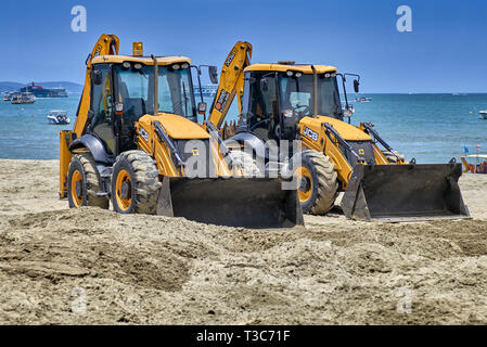 Backhoe working on the beach reclamation project at Pattaya Thailand Southeast - Stock Image