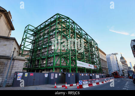 Heavy duty Scaffolding supporting building undergoing deconstruction at Saint Barts Hospital in City of London, London, England, UK - Stock Image