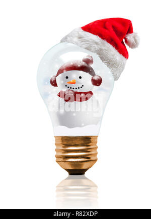 Snow globe light bulb wearing Santa hat with decorated snowman and copy space. Glowing Xmas season and bright New Year. - Stock Image