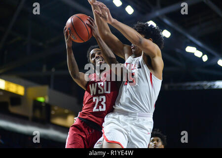 November 14, 2018 - Kent, Washington, U.S - AHMED ALI (23) drives to the basket against TREY'VON HOPKINS (15) as Washington State visits Seattle U at the ShoWare Center in Kent, WA. (Credit Image: © Jeff Halstead/ZUMA Wire) - Stock Image