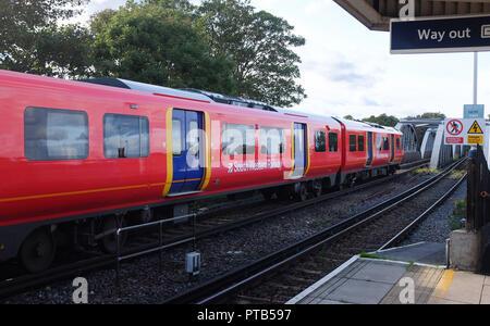 South Western Railways train passing through  Barnes Bridge railway station Mortlake London UK Photograph taken by Simon Dack - Stock Image