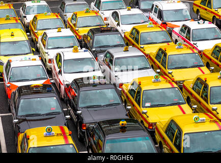 Japanese taxis in front of Fukuoka Hakata Station waiting for passengers. - Stock Image