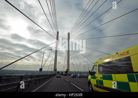 An ambulance travelling over the Queen Elizabeth II 'Dartford' bridge, from Essex to Kent, UK. Space for - Stock Image