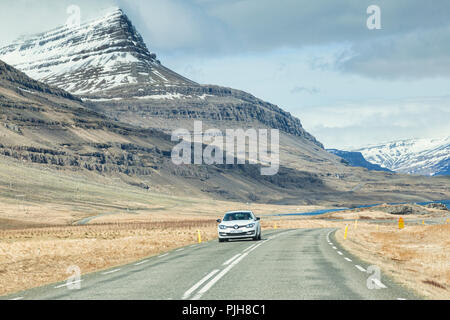 28 April 2018: South Iceland - Through the windscreen shot of the Iceland Ring Road in South Iceland, driving through snowy mountain scenery... - Stock Image