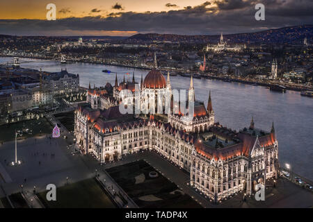 Budapest, Hungary - Aerial view of the beautiful illuminated Parliament of Hungary at dusk with Szechenyi Chain Bridge, Fisherman's Bastion and other  - Stock Image