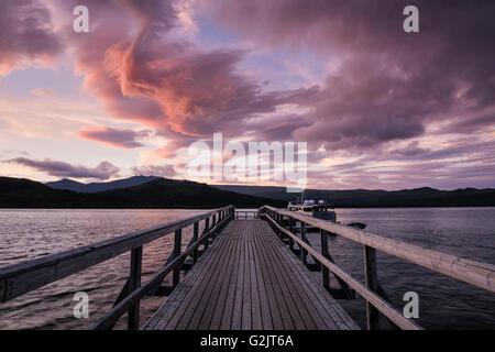 Pier on lake Langas at sunset, Saltoluokta Fjällstation, Kungsleden trail, Lapland, Sweden - Stock Image