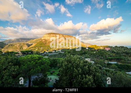 View over sun lit hills on the Amalfi Coast between Sorrento and Positano, Italy - Stock Image