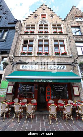 The traditional Cafe Bistro-Brasserie Den Huzaar located in historic centre of Bruges. Belgium. - Stock Image