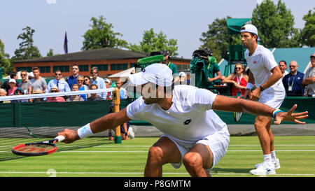 Pakistani tennis player Aisam-ul-Haq Qureshi and Dutch player Jean-Julien Rojer, on court in men's doubles match, All England Lawn Tennis Club, Wimble - Stock Image