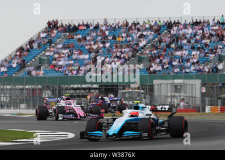 Silverstone Circuit. Northampton, UK. 13th July, 2019. FIA Formula 1 Grand Prix of Britain, Qualification Day; Lance Stroll driving his SportPesa Racing Point F1 Team RP19 chases down Robert Kubica driving his ROKiT Williams Racing FW42 Credit: Action Plus Sports/Alamy Live News - Stock Image