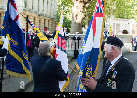 Portsmouth, UK. 15th Aug, 2015. Standard bearers gather their flags in advance of the VJ Day 70th anniversary memorial - Stock Image