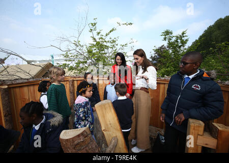 The Duchess of Cambridge speaks children during a visit to her garden at the RHS Chelsea Flower Show at the Royal Hospital Chelsea, London. - Stock Image