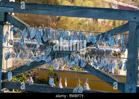France, 2018, Copying the tradition of attaching locks to bridges, Château-d'Oléron started the habit of tying oyster shells with wishes and dreams wr - Stock Image