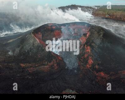 View using an Unmanned Aerial Vehicle into the fissure 8 lava cone in the Kilauea volcano showing a low level of activity September 5, 2018 in Hawaii. After three-months of continuous eruption the volcano has halted activity and appears to be over for the time being. - Stock Image
