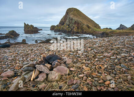 Cobbly beach in the coastal village of Portknockie on the north coast of Scotland, UK - Stock Image
