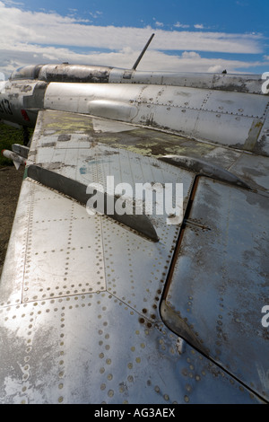 Aluminium MiG-21 retired aircraft, wing as shown is extremely weathered and in patchy condition - Stock Image