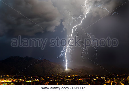 A huge lightning bolt strikes the side of the Santa Catalina Mountains near Ventana Canyon summer monsoon thunderstorm - Stock Image