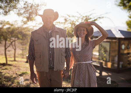 Senior couple holding hands - Stock Image