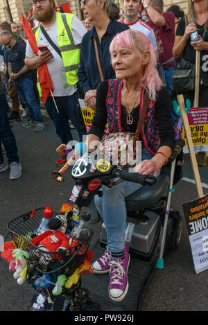London, UK. 13th October 2018.   A woman on a mobility vehicle at the rally in London to oppose racism  and fascism close to where the racist, Islamophobic DFLA were ending their march on Whitehall bringing together various groups to stand in solidarity with the communities the DFLA attacks. The event was organised by Stand Up To Racism and Unite Against Fascism. Peter Marshall/Alamy Live News - Stock Image