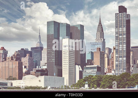 New York City skyline seen from the Roosevelt Island, color toning applied, USA. - Stock Image