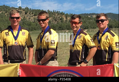 RATON, N.M.—Sgt. Tyler Payne, Staff Sgt. Joel Turner, Sgt. 1st Class Daniel Horner and Sgt. Matthew Sweeney, U.S. Army Marksmanship Unit, (from left to right) won the gold in the team championship match during the 2016 Rocky Mountain Championship Aug. 11-14. Horner, Turner and Sweeney received individual gold medals for their shooting divisions—limited scope, limited iron and he-man scope, respectively, and Payne won a silver medal in the open division. - Stock Image