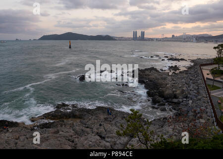 Seascape in Busan, South Korea, with city in the far horizon. - Stock Image