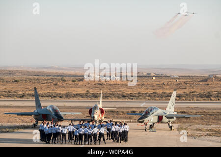 Hazerim Air Base, Israel. 27th June, 2019. Newly certified Israel Air Force pilots and navigators celebrate their successful completion of one of the most competitive and rigorous training processes in the IDF at Hazerim Air Base in the Negev Desert. Credit: Nir Alon/Alamy Live News. - Stock Image