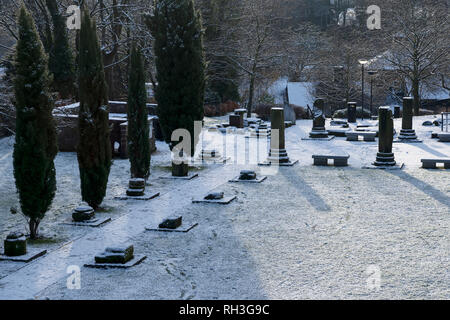 The Roman Gardens in Chester city centre covered with a light dusting of snow - Stock Image