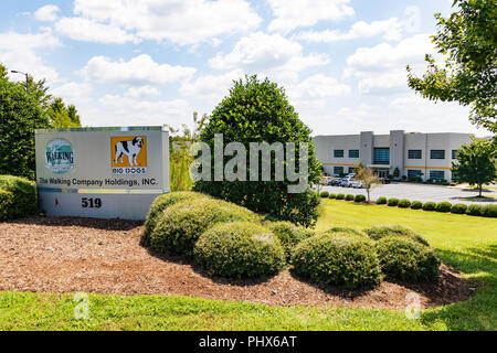 Lincolnton, NC, USA-8-25-18: Road sign and distribution center for the Walking Company and Big Dogs, a California-based retailer of shoes. - Stock Image