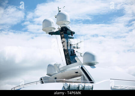 Part of the ship or vessel or yacht against the blue sky. Concept of summer sea vacation or cruise. - Stock Image