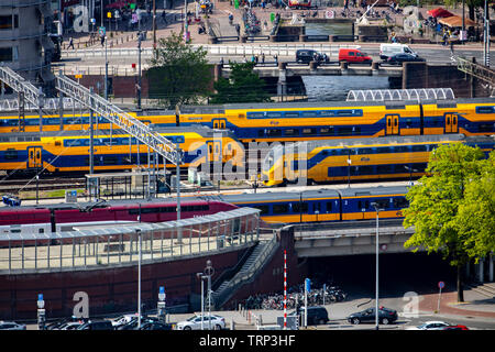 Amsterdam, Netherlands, local and intercity trains at Amsterdam Central Station, - Stock Image