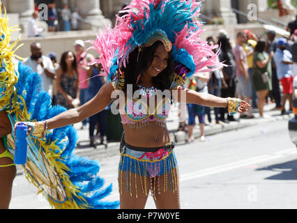 Montreal, Canada. 7/7/2018. A costumed woman participates in the Carifiesta parade in downtown Montreal. Credit: richard prudhomme/Alamy Live News - Stock Image