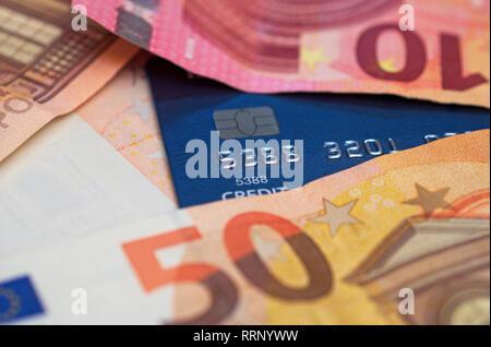 euro banknotes and credit card - Stock Image