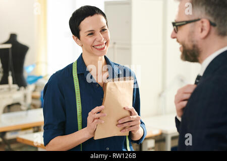 Cheerful tailor - Stock Image