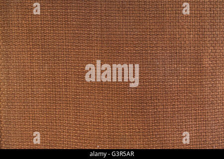 Brown canvas material textured background. - Stock Image