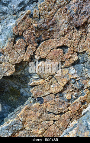 Possibly iron stained stone texture on Cornwall coast. - Stock Image