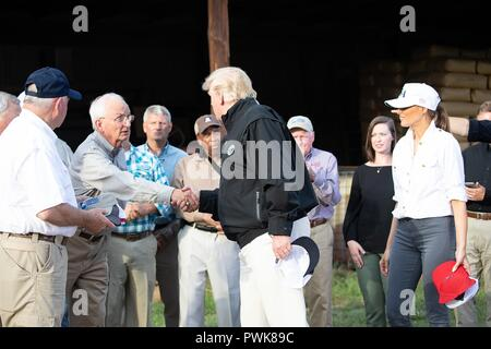 Panama City, Florida, USA. 15th Oct 2018. U.S President Donald Trump and First Lady Melania Trump meet with local farmers to discuss the impact of Hurricane Michael on crops at Charlie Stewarts Farm October 15, 2018 in Macon, Georgia. Credit: Planetpix/Alamy Live News - Stock Image
