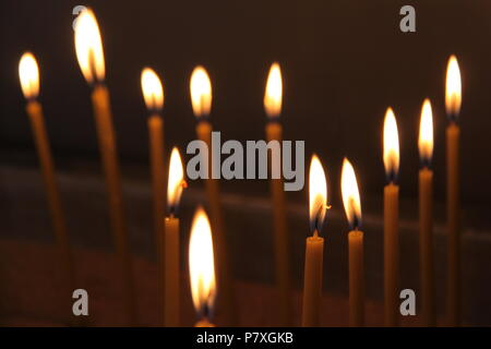 Candles lit in memory of people deceased at the old Agios Andreas monastery at Peratata on the island of Kefalonia, GRECCE, PETER GRANT - Stock Image