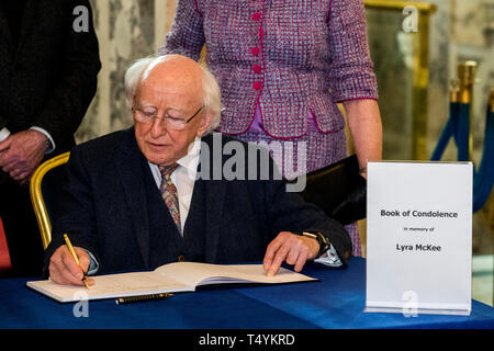 Irish President Michael D. Higgins signing the book of condolence at Belfast City Hall in remembrance of murdered journalist Lyra McKee. - Stock Image