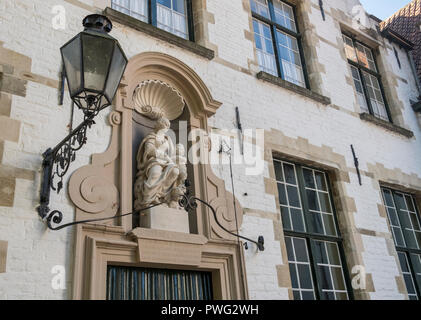 Exterior detail of a Begijnhof (Beguinage) house, one of the white 17th-century houses now home to Benedictine Nuns, Wijngaardplein, Bruges, Belgium - Stock Image