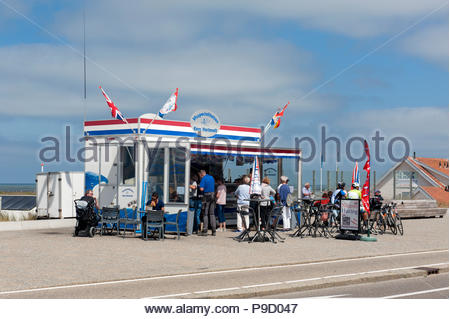 Katwijk The Netherlands Cyclists stop for seafood at a stall along the seafront. - Stock Image