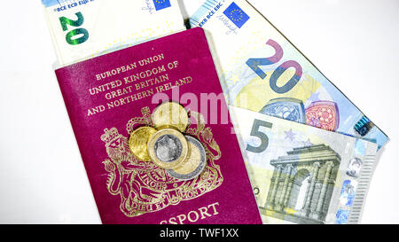 European Currency Euros Bank Notes and Coins With a British Passport - Stock Image
