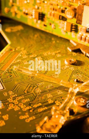 Close-up of gold and green computer circuit board details, Studio Composition, Quebec, Canada - Stock Image