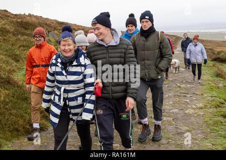 Ramblers walking between Christmas and New Year, on Valentia Island county Kerry Ireland - Stock Image