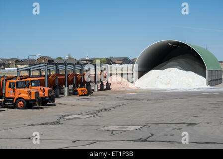 Winter Road Salt Storage Warehouse and and Snow Plows - West Jordan, Utah - Stock Image