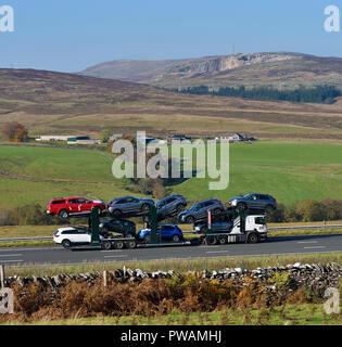 BCA Automotive Limited car transporter HGV. M6 Northbound carriageway, Shap, Cumbria, England, United Kingdom, Europe. - Stock Image