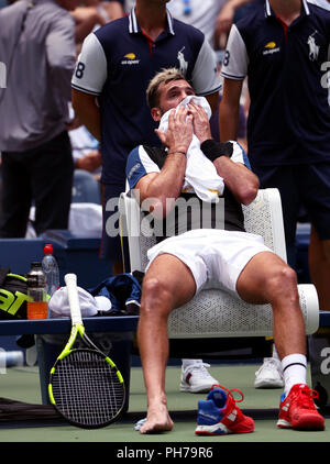 Flushing Meadows, New York, USA. 30th Aug 2018. August 30, 2018: US Open Tennis: Benoit Paire of France resting during a change over during his second round straight set loss to Roger Federer of Switzerland at the US Open in Flushing Meadows, New York. Credit: Adam Stoltman/Alamy Live News - Stock Image